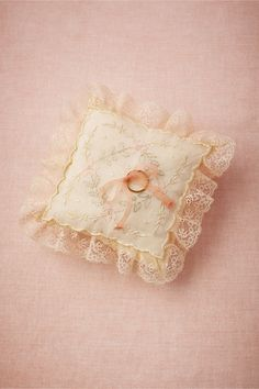 Antique Ring Pillow from BHLDN We scoured our favorite antique markets to find this heirloom pillow! Embroidered with delicate ivy hearts, a slender ribbon secures the wedding bands, making it ring bearer-ready.