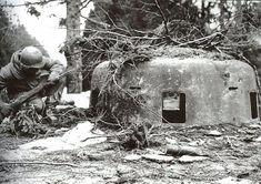 US soldier investigates German bunker.