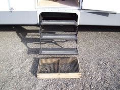 Create a step for the outside out of a grill from an old gas grill - build a box out of a 2×4 and attach the grate from the grill to the top - when you step on this before you step into the camper, a lot of the dirt and stones that are on the bottom of you shoes gets knocked off