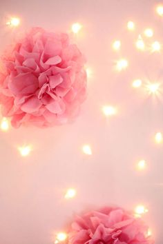 The backdrop is made by poking holes through the canvas with a sharpened nail. Push string lights through holes after deciding on the pattern you want to make. Use glue dots to keep the lights in place.