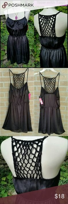 """NEW Strappy-Back Dress LBD - Small Xhilaration  New with Tags Black Silky Dress UPC 492820927672 Size Small  """"LBD"""" = Little Black Dress  Ruffled neckline, with lace at upper back. Adjustable straps, gently elasticized waist. 100% Polyester   Bust 34-36"""" Elasticized Waist 26-34"""" Hips 43"""" Length from top of shoulder to bottom edge 35""""   Perfect condition, new with tags attached, from nonsmoking home. Xhilaration Dresses Mini"""