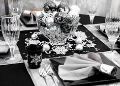 black and silver wedding table setting with snowflakes and bling