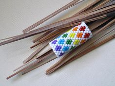 Inside the Rainbow - Peyote Stitch Dread Sleeve by knottysleeves, via Flickr