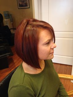 Inverted bob haircut with red color and red highlights