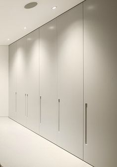 Close-up, floor to ceiling closets inside the Villa Escarpa by Mario Martins Wardrobe door are a good choice SIMPLE