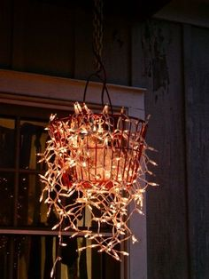garden chandelier-Christmas lights+old egg collecting metal basket.