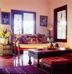 Bohemian Living Room...while I like the pink, soft bedroom - want a bold, cozy living room.  Like the table and little seats.  Bright reds and oranges.