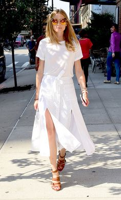 Olivia Palermo works all-white everything, teaming her classic tee with a broderie anglaise skirt, complete with double split. The real hero of this outfit, though? Those cat eye sunglasses. Me-owwwww.