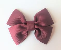 Grosgrain single layer double bow Material: Grosgrain Choose your back: * French Barrette Clip * Elastic Head Band - made to measure * Brooch Clip * Nothing (great for adding the finishing touch to the perfect gift). Barrette Clip, Grosgrain, Burgundy, Bows, Gifts, Ticks, Arches, Presents, Bowties