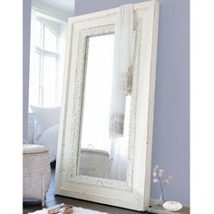 Antique white mirror with an oriental touch