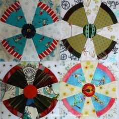 Steam Punk quilt blocks These nine-inch blocks resemble airplane propellers or (my husband says) the old TV test pattern. Love the fussy cut women!
