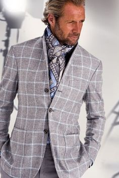 Masculine and Elegance man in grey suit and scarf