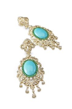 Earrings by renowned Indian designer and gemologist Farah Khan. Her passion for jewellery design and perfectionist persona has made her a favorite among Bollywood celebrities and international clients.   Earrings with turquoise stone   http://thefuturist-pdlg.com/