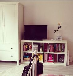 Instead of separate tv stand, use bookcase