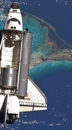 (space shuttle atlantis docking with the international space station over the bahamas).