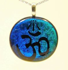 Check out this item in my Etsy shop https://www.etsy.com/uk/listing/239464845/dichroic-glass-om-and-awen-pendant