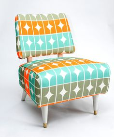 I love the colors on this fun and funky slipper chair. Would make a great accent chair on the living room or the kids' bedroom