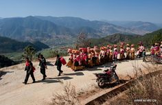 Traditional wedding held in Sichuan, China. A Lisu wedding procession made up of members from the bride's side heads for the groom's home in Xinyu Village of Dechang County, southwest China's Sichuan Province, Feb. Sichuan China, Traditional Wedding, Reading Online, Hold On, Dolores Park, Earth, Places, Travel, Outdoor
