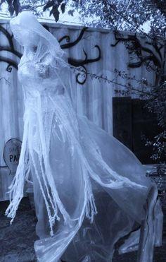 2015 Halloween ghost yard decoration make of packing tape - girl, dress, cape - Most creepy & creative Halloween ghost decoration ideas that you will like 2015 by 2014Fashionideas
