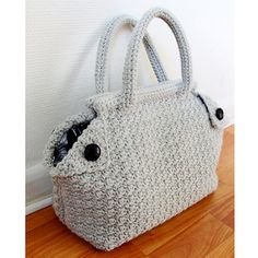 Free Crochet Bag pattern. .  The pattern includes detailed instructions, including how to make and attach the lining.