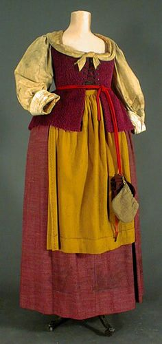 Dress of servant (front) under Louis XIII  era, 1610-1660. Colonists in the New World of similar social station would dress more like this than the court fashions.