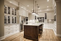 white, stained island, pendants, built-in china cabinet (by Veranda Interiors)