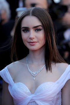 Lily Collins Photos Photos - British actress Lily Collins attends the 'Okja' screening during the 70th annual Cannes Film Festival at Palais des Festivals on May 19, 2017 in Cannes, France. Celebrities, fans and the movie world have descended on Cannes for this year's festival of the screen. For seventy years The Croisette Boulevard has always been the centre of athe place watch the rich and dandy and people from all walks of life to promenade. - A Celebration of All Things Cannes - 70 Years…