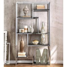 Add a metallic accent to your home with this statement bookcase. Choose from chrome or champagne to enhance the shined metal framework while the six espresso finished shelves offer room to display you