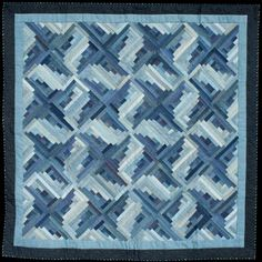 Stepping Out in Denim; quilt by Flavin Glover  just straight stitching with logs-very effective