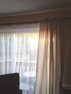 DIY - hiding apartment vertical blinds with curtains.