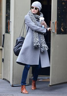 Bundled up: Emma Stone exited a restaurant in New York City on Sunday smartly covered up...