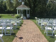 Loved it! Pinned it! A Blooming Envy Design! Wedding aisle with buckets of baby's breath.
