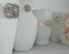 Decorate a vase with ribbon and one of your broken jewelry creation.  These are very girly.