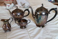 Silver tea and coffee pot with cream and sugar containers