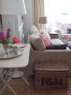 Love this distressed folding table and the floral pattern on the sofa.