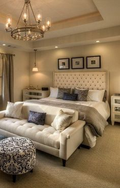 Beige and silver gray master bedroom with industrial chandelier.