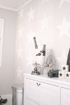 I like the light grey walls with the white accents (stars), can do something similar with light pink and white
