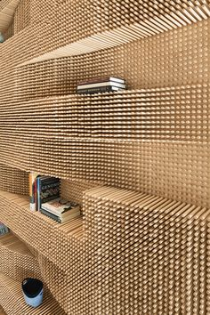 3D dowel walls. 40,000 dowels in pegboard make unique undulating shelves...weird!