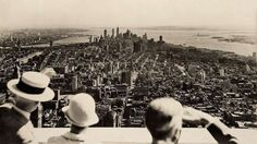 <p>Visitors admire the view of downtown Manhattan from the observation deck of the Empire State Buil... - Purpleclover.com