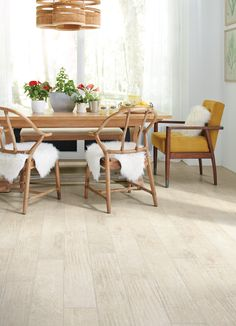 Faux fur décor is trending this year and so is gorgeous Luxury Vinyl Plank flooring like this one! Vinyl Tile Flooring, Luxury Vinyl Flooring, Luxury Vinyl Tile, Luxury Vinyl Plank, Wood Parquet, Home Trends, Floor Rugs, Latte, Dining Chairs