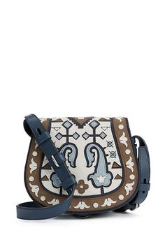 A beautiful show of craftsmanship, straight from our fall runway: The Patchwork Mini Saddlebag is made with more than 100 pieces of individually cut — and layered — leather and suede | Tory Burch Fall 2015