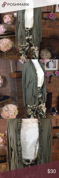 Floral trouser and cardigan combination Larry Levine floral ankle length trouser. Size 20W. 48 inch waist and 26 inch inseam. Cream tank top with no stretch Size 2X. It has a 52 inch circumference. APT 9 green cardigan size 3X. Cardigan has pockets and a front ruffle. Previously owned. Please look at all pictures for best description of the items. Ask me any questions and happy shopping. Larry Levine Pants Ankle & Cropped