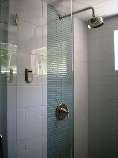 white shower tile--interesting variation of tile size with vertical stripe of glass tile