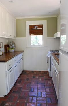 galley kitchen makeover for under $1,500.  like the brick floors, though that would probably be weird in our kitchen since we have exposed brick on the wall.