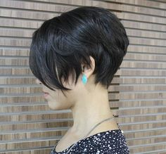 stacked and layered bob is simple and easy to maintain. Bangs are left longer in front, and the back is short enough to show off the ears.