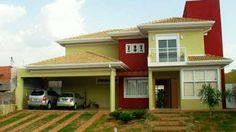 Fachada casa pintada por fuera de rojo