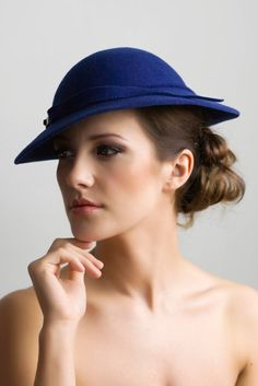 Belle is a classic style hat, it is designed to sit at a slight angle therefore framing your face and adding the illusion of height, however it