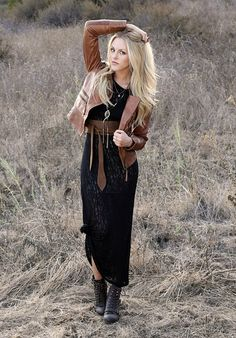 Long black dress, leather jacket and military boot