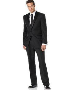 Groom and his groomsmen.. back suit, black tie. Simple is key.
