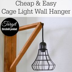 Target Hack: Diy an Industrial Cage Light Wall Hanger Super cheap and easy diy wood wall hanger! Find this and MORE diy's at foxhollowcottage.com